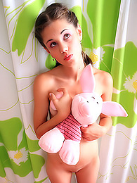 Teeny trades games with her favorite plush piglet for hot nude posing pictures