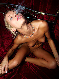 Skinny naked girl smokes cigar pictures at freekilosex.com