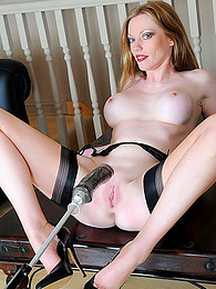 Foxy milf sucks a toy pictures at freekilosex.com