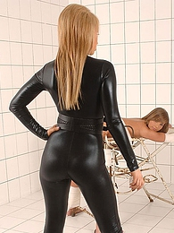 Leather catsuit girl spanks submissive pictures at freekilosex.com
