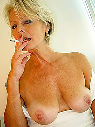Mature blonde smokes lustily pictures at find-best-panties.com