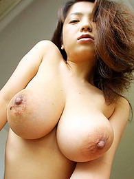 Busty Asian teases us pictures at freekiloclips.com
