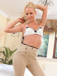 Playful blonde babe Sara strips her jockey uniform pictures at freekiloclips.com