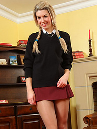 Pigtailed coed Ruby Love hikes up her skirt showing panties thru pantyhose pictures