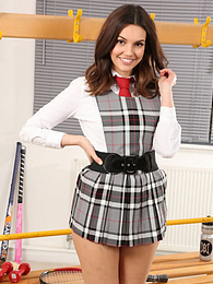 Lovely brunette schoolgirl Abigail shows her white panties pictures at freekilomovies.com