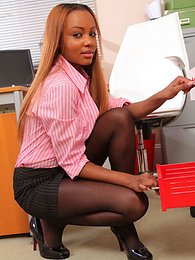 Ebony secretary Zena in tight miniskirt undresses in office pictures at freekiloclips.com