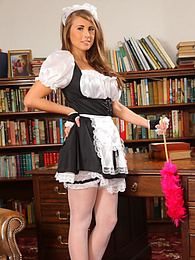 Busty brunette maid Sarah McDonald undresses pictures at freekiloporn.com
