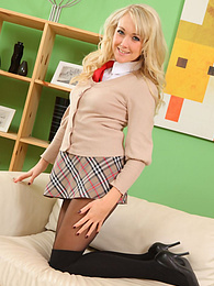Dazzling blonde college teen Lucy Anne peels off her skirt pictures at freekiloclips.com