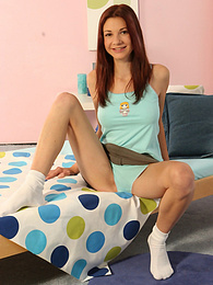 Brunette babe Angela plays up in the bedroom pictures at freekilosex.com