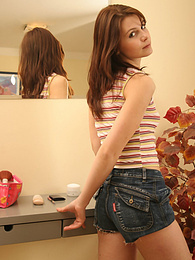 Awesome teen checks herself out in the mirror pictures at kilovideos.com