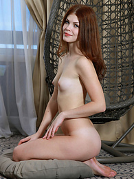 This horny doll burs with lust as she hangs in her chair where she freely embraces all of her sexy feminine beauty pictures