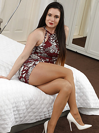 Tommy from Only Tease in a sexy black dress and stockings pictures at kilovideos.com