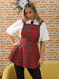 Blondie Rose from Only-Costumes poses as Dorothy in a minidress, heels and stockings pictures