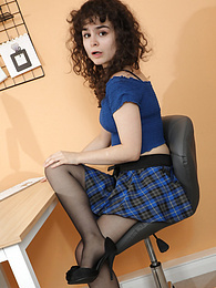 Karen Holster from Only Tease in a short plaid skirt and pantyhose pictures at find-best-videos.com
