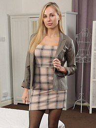 Cassie B from Only Tease in a minidress, sexy heels and stockings pictures at freekilomovies.com